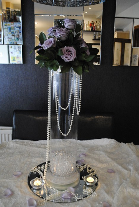 Tall Cylinder vase with fresh lilac roses & draped pearls