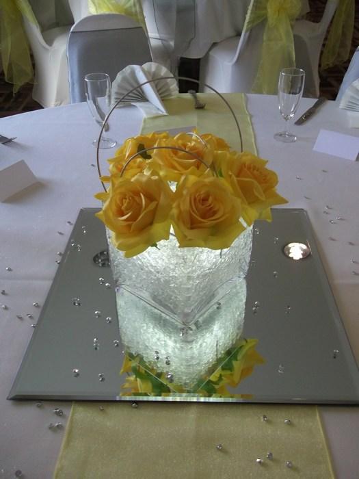 Square vase with yellow roses & silver canes