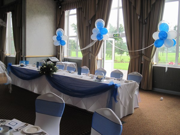 Cloud 9 in royal blue & white behind top table