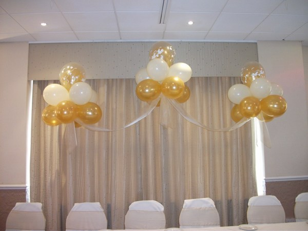 Cloud 9 in gold & white behind top table