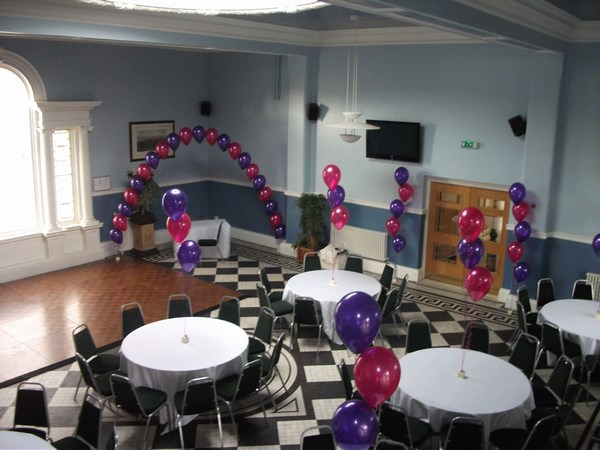 single pearl balloon arch in cadbury & hot pink for the dance floor