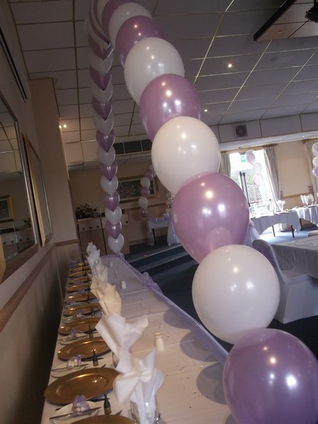 single pearl balloon arch in baby pink & white in front of top table