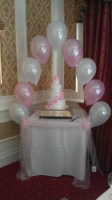 single pearl balloon arch in baby pink & white over the cake table