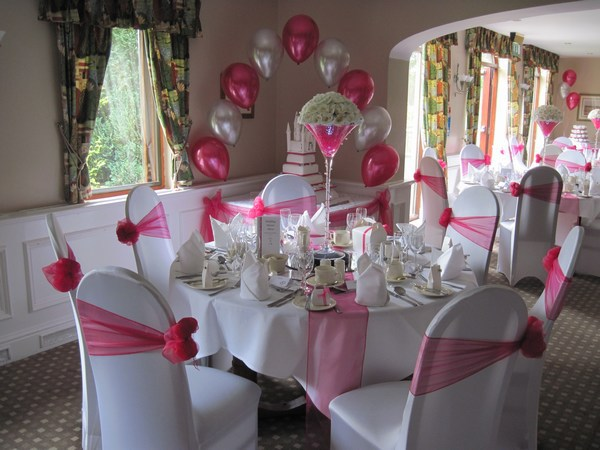 single pearl balloon arch in hot pink & white over the cake table