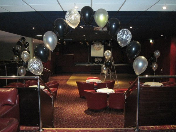 single pearl balloon arch in black & silver over stairs