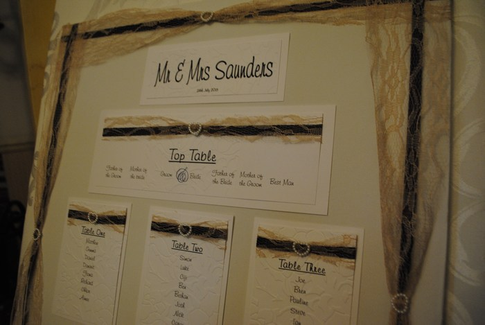 Lovely Lace table plan with menu on reverse, in champagne lace & purple satin underlay, close view