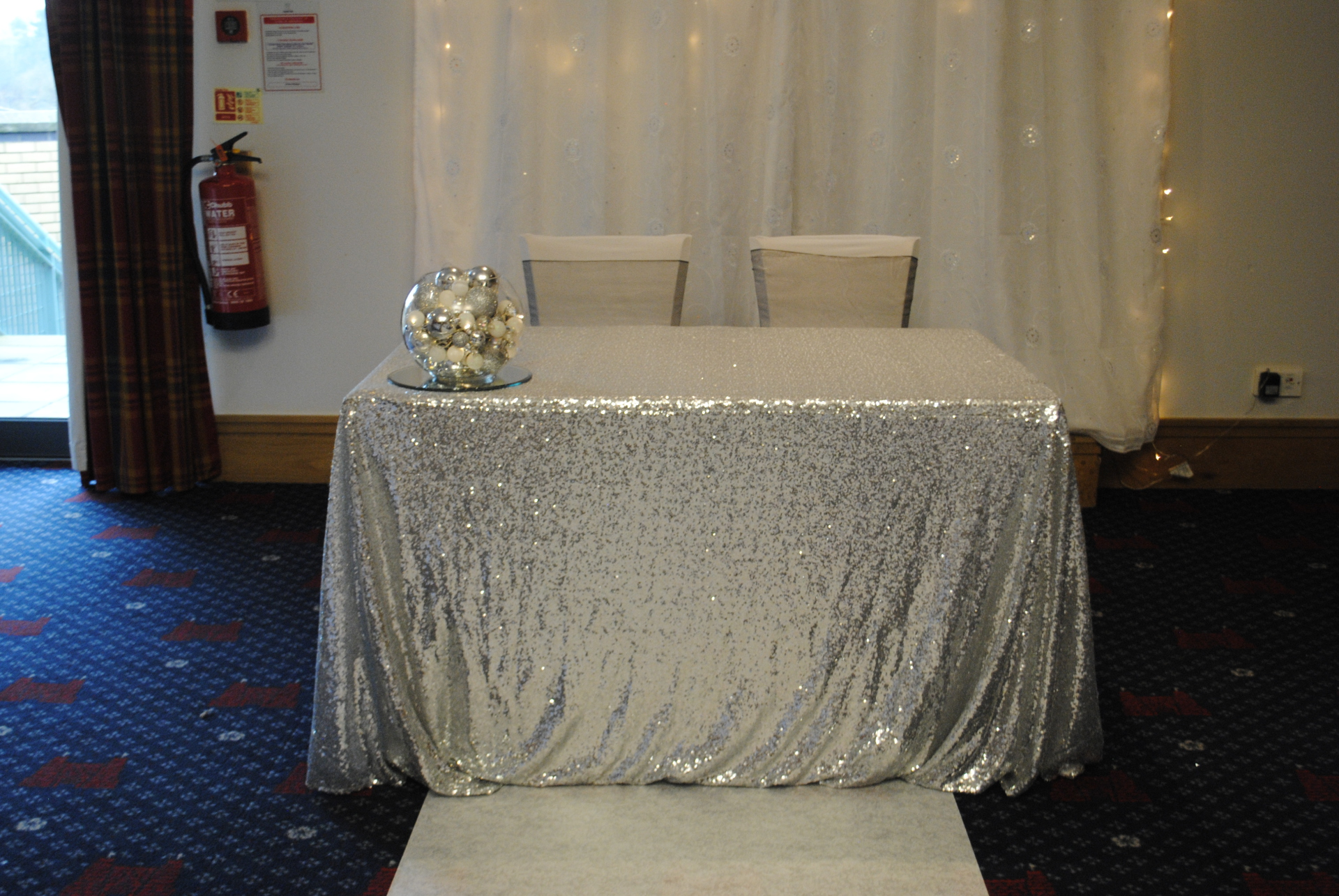Silver sequin civil or cake table cloth hire