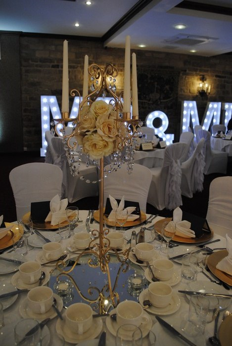 Gatsby Gold Candelabra with diamante drape garlands and cream artificial roses
