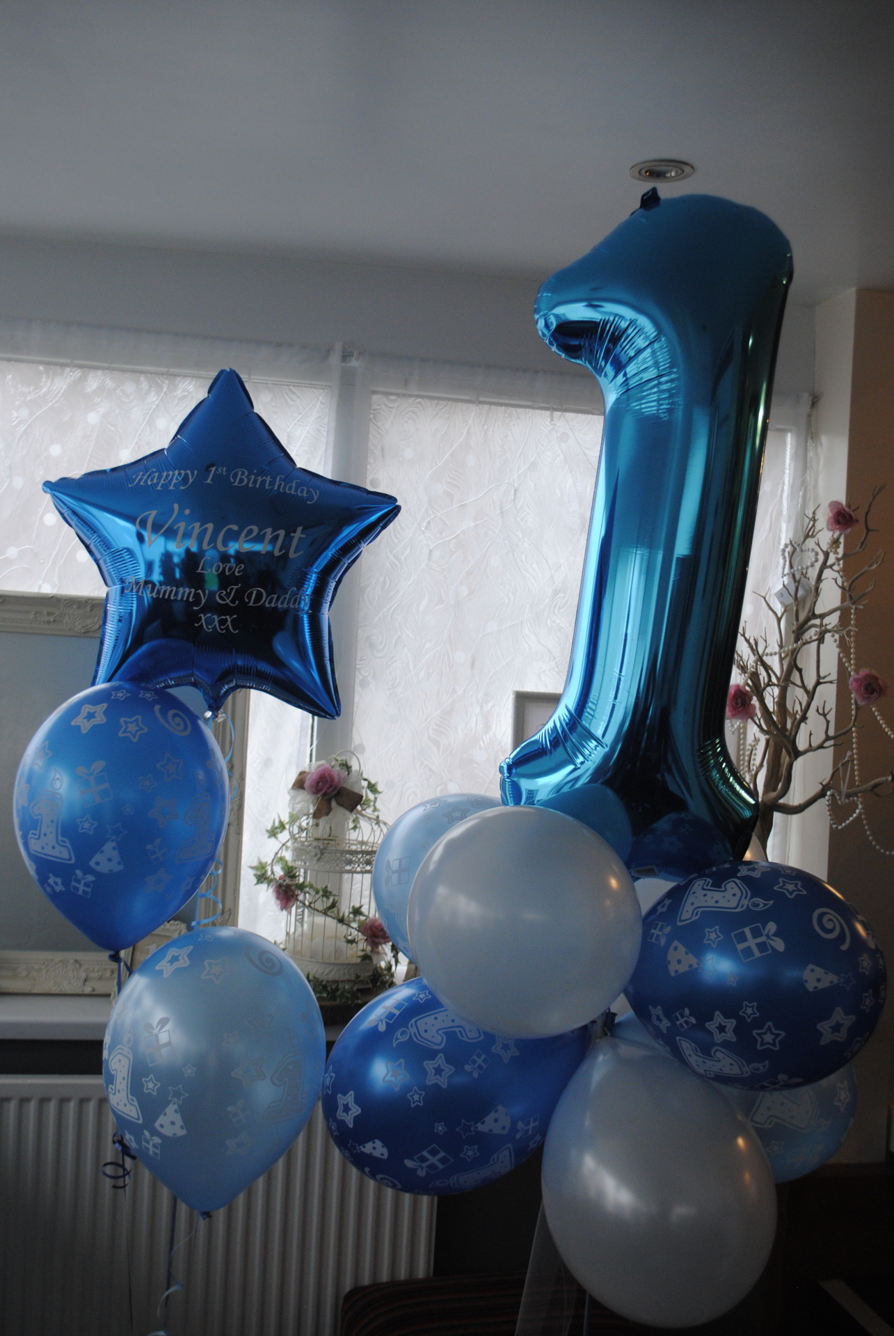 Foil Numbers - 1st birthday in blue in a cloud cluster