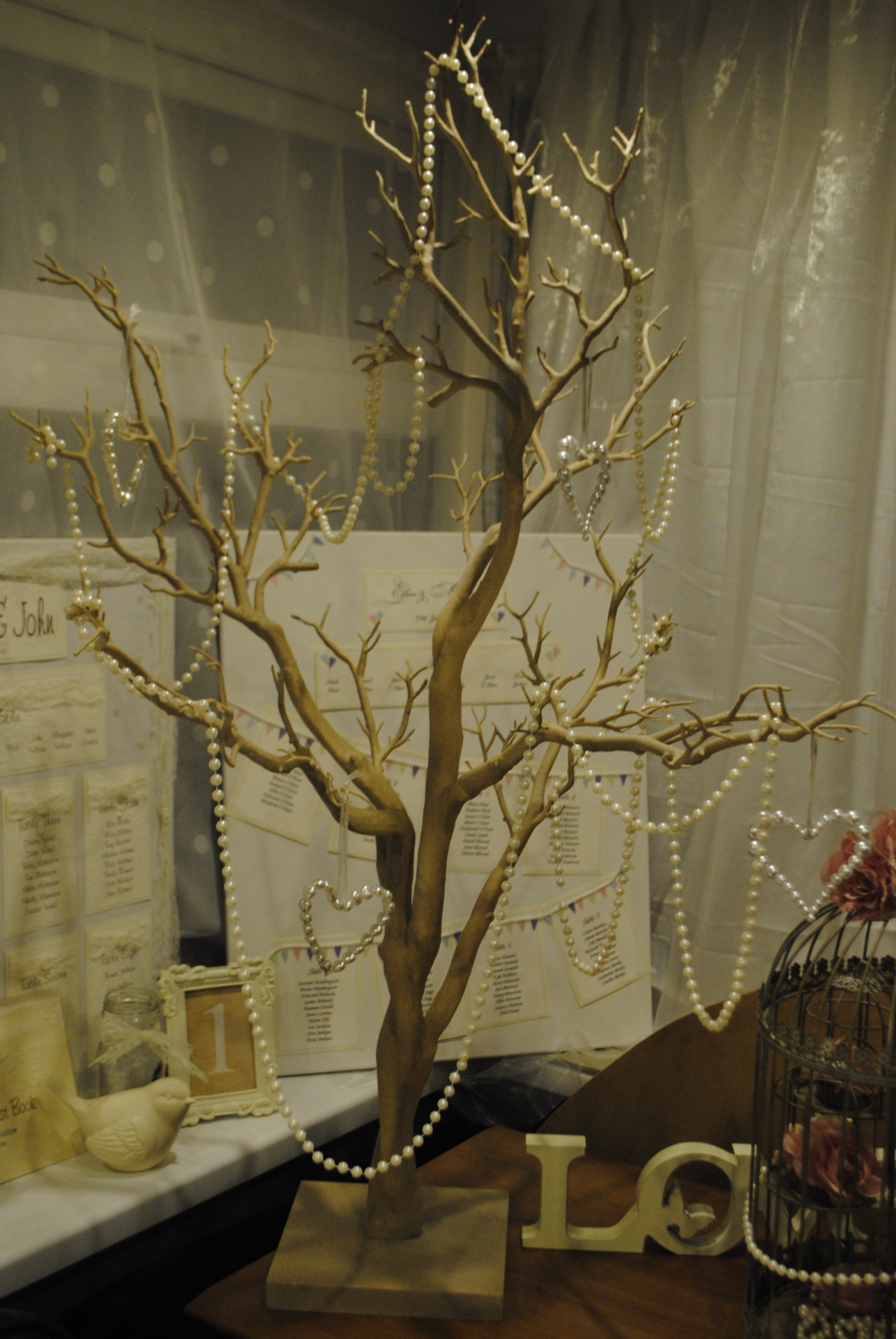 Rustic Manzanita Tree with pearl garlands and hanging pearl hearts