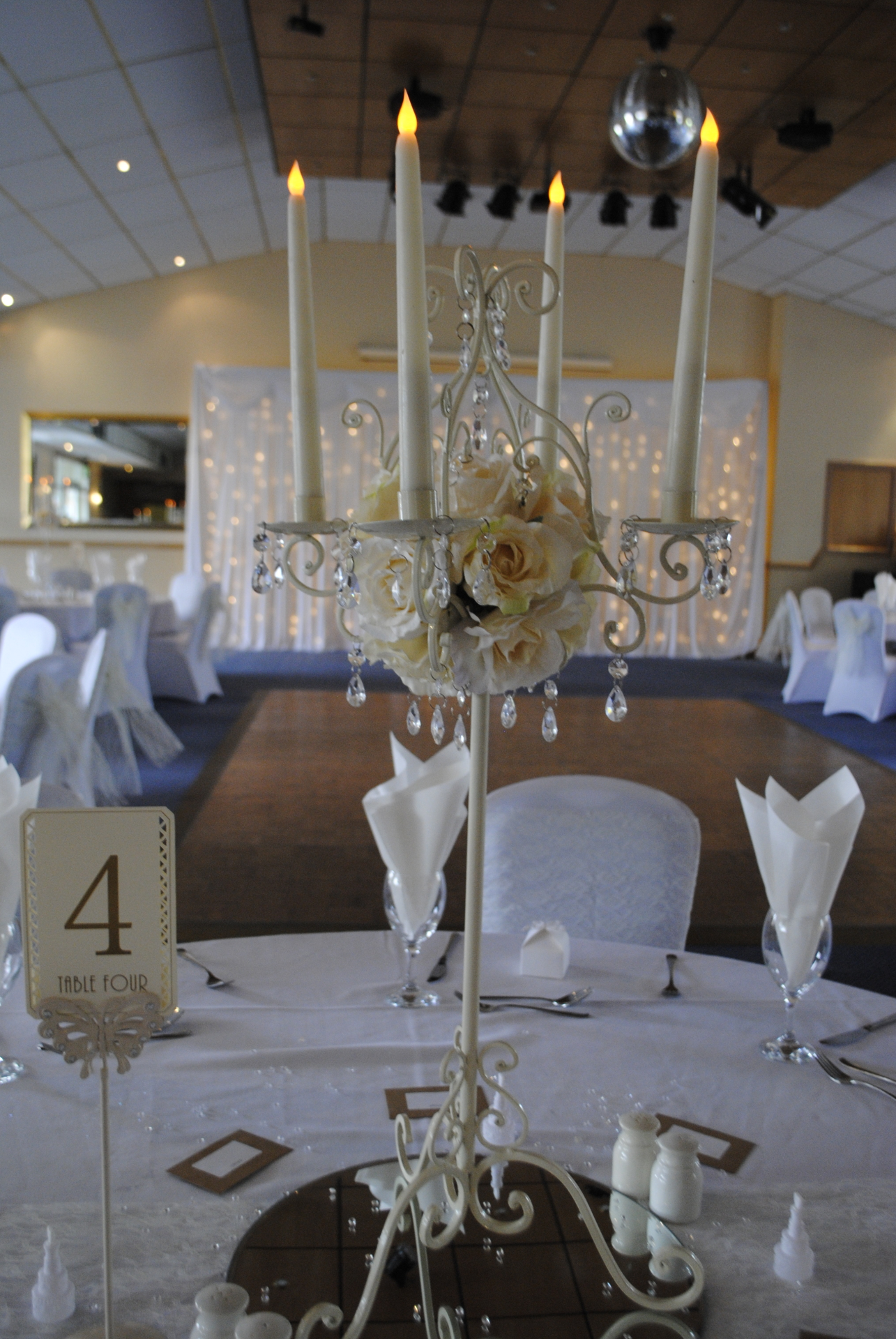 Tall Ivory candelabra with artificial cream rose balls