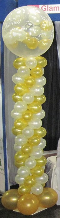 Balloon Column with gumball topper with mini balloons inside in white & gold