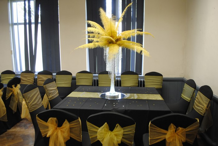 Ostrich feather Centrepieces with Gold Feathers and Crystal Skirts