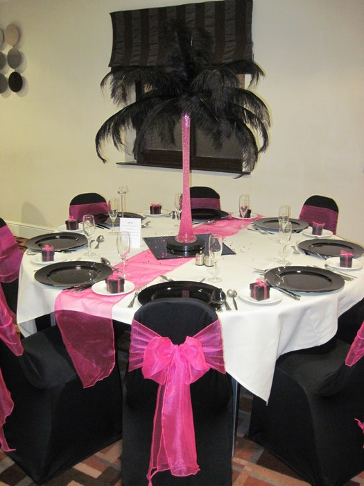 Ostrich Feather Centrepieces with black feathers &  hot pink stems