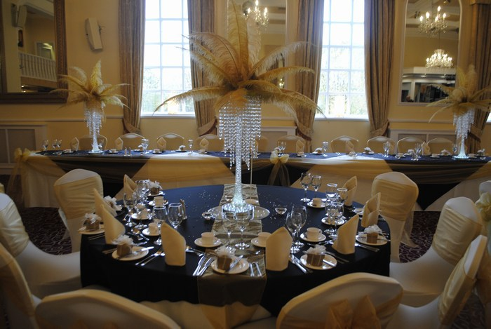 Ostrich Feather Centrepieces & Gold Feather & Crystal Skirts