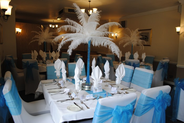 Ostrich Feather Centrepieces with aqua stems