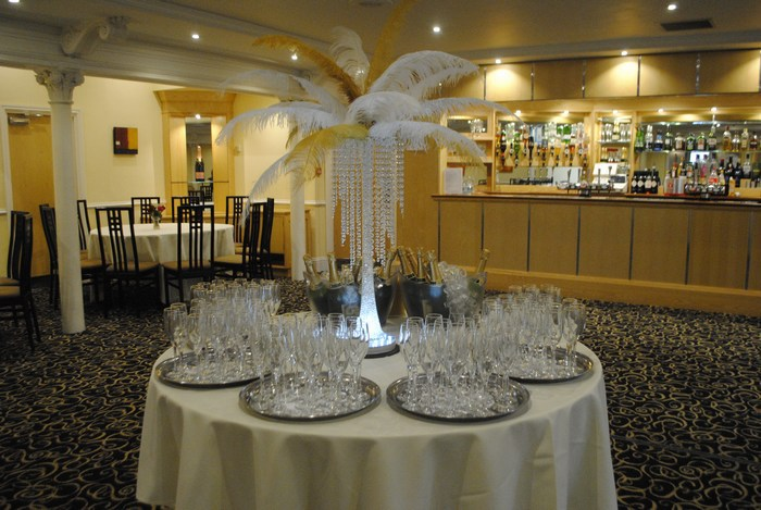 Ostrich Feather Centrepieces with white and gold feathers & crystal skirts