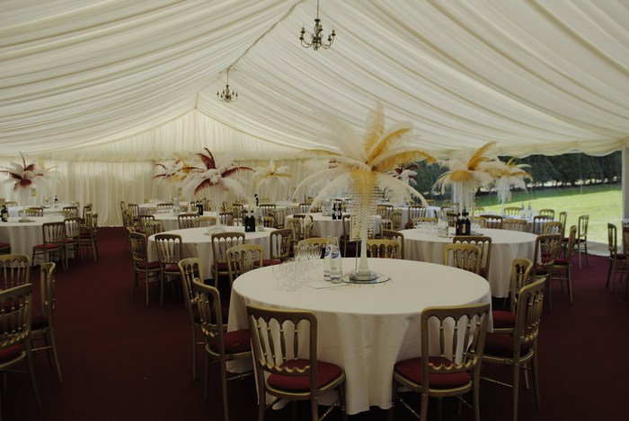 Ostrich Feather Centrepieces with white and gold and Burgundy and white feathers and crystal skirts