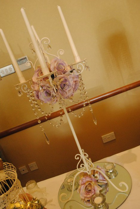 Tall Vintage Ivory Candelabra with artificial lilac roses and diamante draped garlands