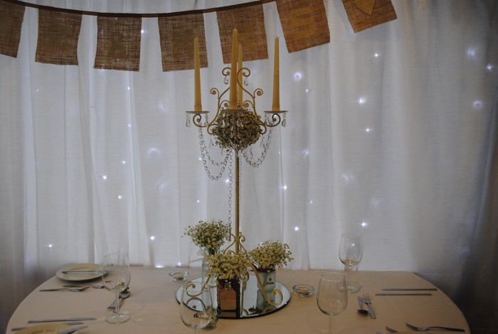 Tall Vintage Ivory Candelabra with fresh gyp, fresh gyp in jam jars & draped diamante garlands