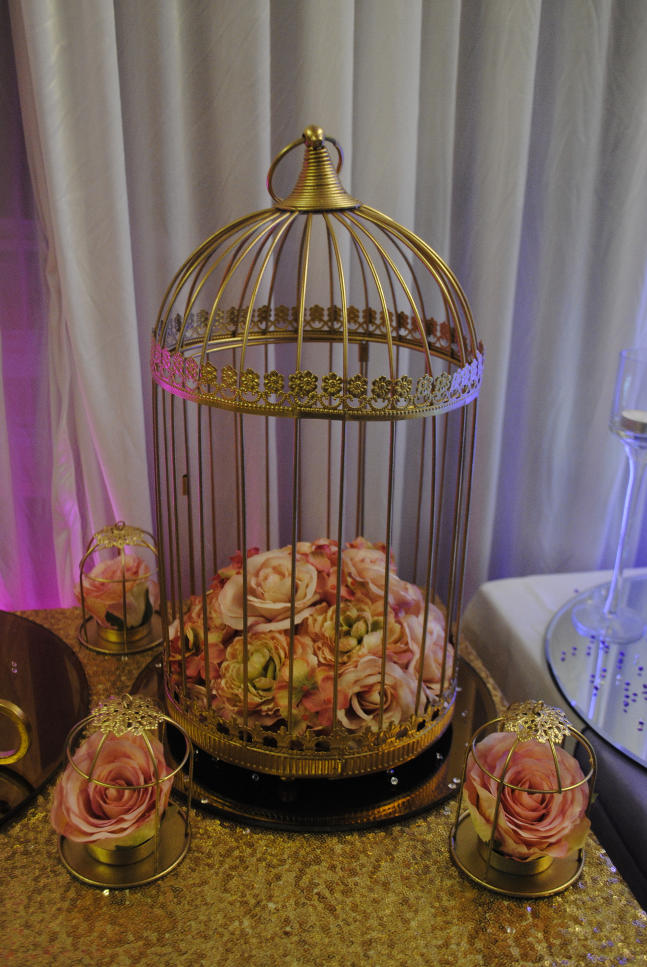 Metallic Gold Birdcage with mixed pink flowers
