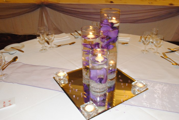 Trio of cylinders with artificial purple orchids
