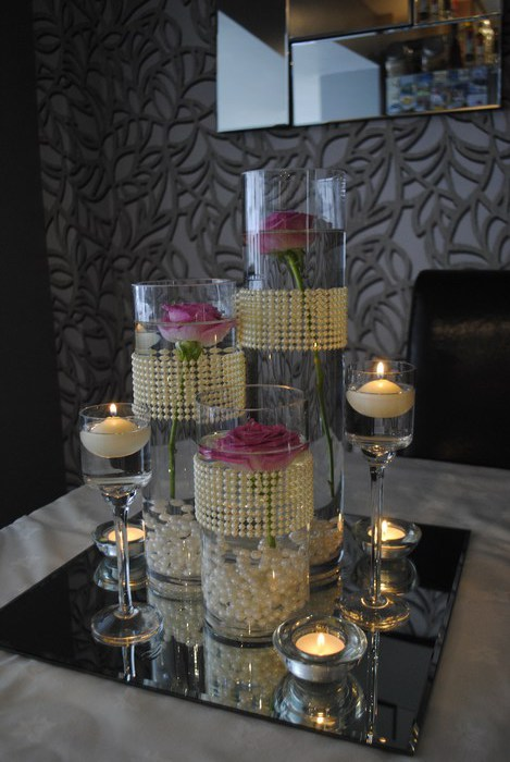 Trio of cylinders with fresh pink roses