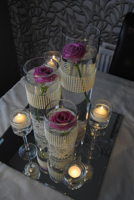 Trio of cylinders with fresh pink roses top view