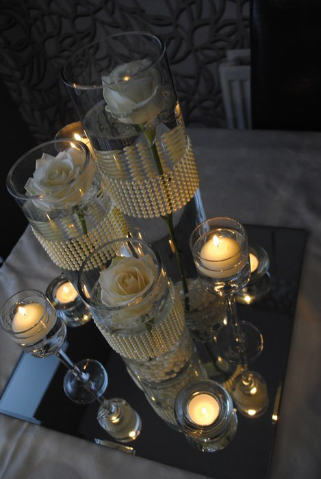 Trio of cylinders with fresh cream roses top view