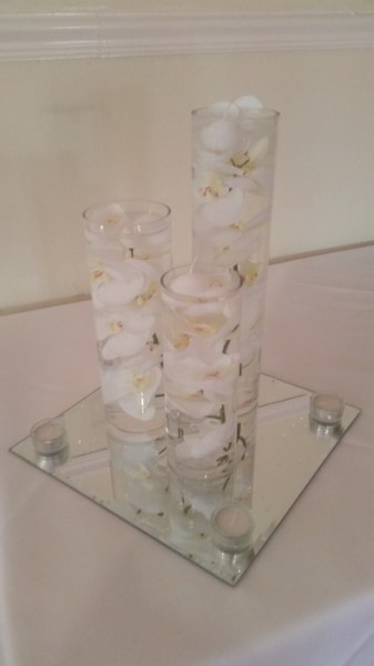 Trio of cylinders with artificial white orchids