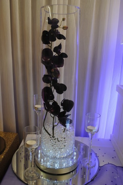 Tall Cylinder with pruple orchids