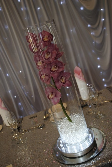 Tall Cylinder with fresh orchids