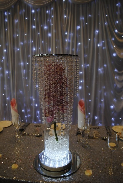 Tall Cylinder with fresh orchids and crystal skirt toppers
