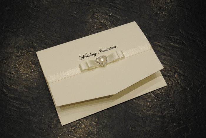 Dior bow pocket fold invitation in Ivory