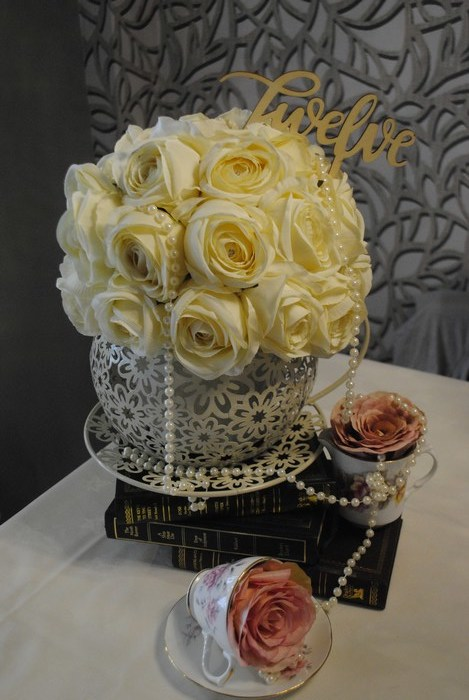 Giant teacup with cream rose dome & and draped pearls
