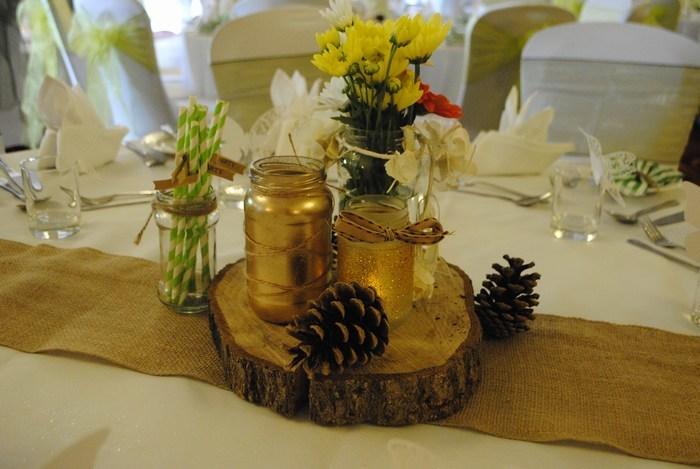 Jam jars with coloured flowers & pine cones