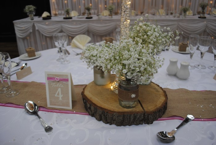 Jam jars around centrepiece with fresh gyp