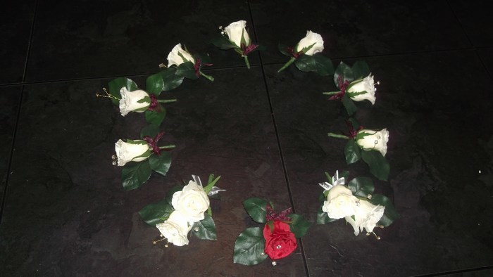Buttonhole in artificial cream & red roses