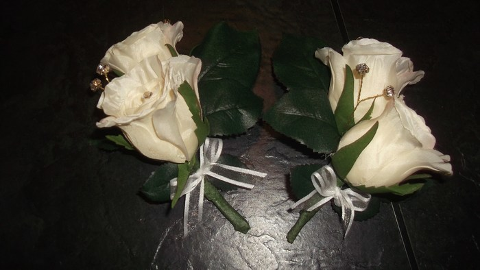 Buttonhole in artificial cream roses
