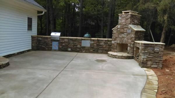 exterior-cool-outdoor-living-spaces-decoration-using-black-iron-metal-outdoor-chair-including-tall-square-grey-stone-fire-pit-and-light-grey-stone-brick-waterfall-in-garden-charming-images-for-outdoo.jpg