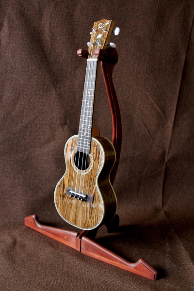 Bokote ukulele on original cherry instrument stand