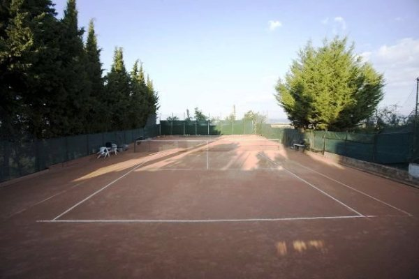 Go head-to-head in a game of tennis on the clay court