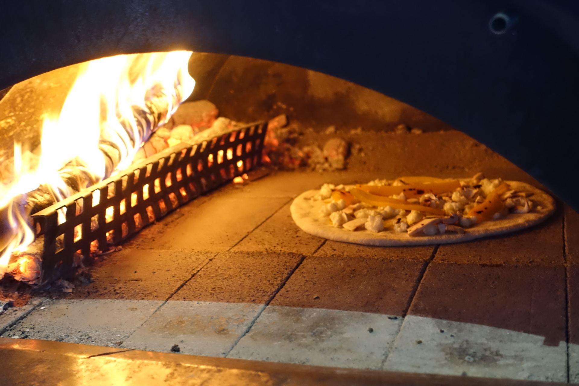 Complete With An Outdoor Wood-fired Pizza Oven