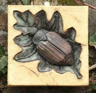 May Bug, Cockchafer, bass relief sculpture, wall hanging sculpture, Ama Menec sculpture.