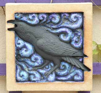 Raven sculpture, raven art, raven relief, electric blue glaze, Ama Menec sculpture, bas relief sculpture, British wildlife sculpture, wildlife art.