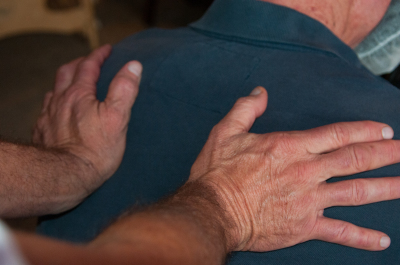 Compressions being provided on the upper back of a client, just as an introductory to the many differant modalities that we are trained to provide.