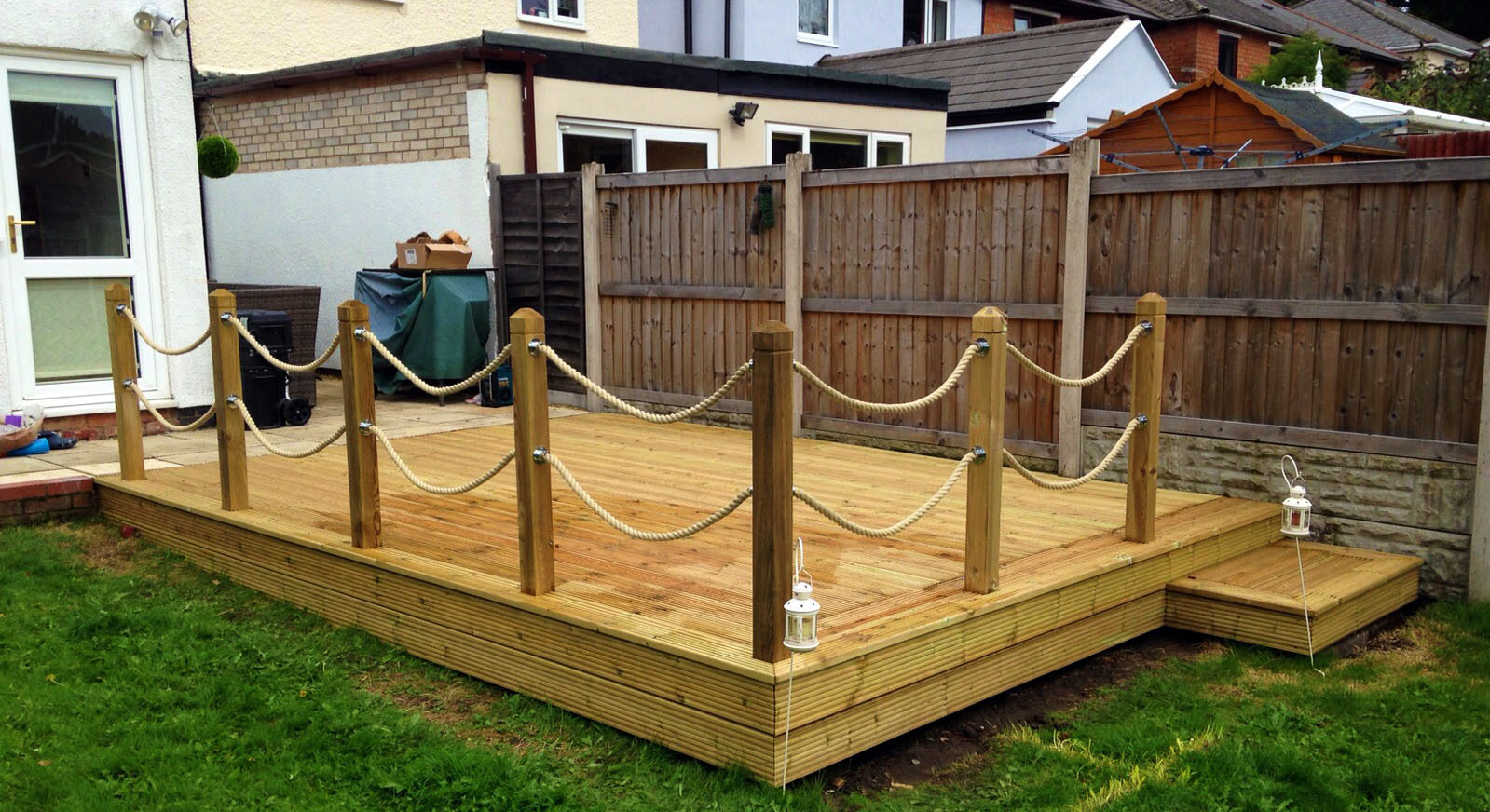 Traditional softwood deck with thick rope railings.