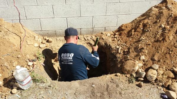 plumber digging