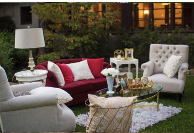 berry sofa / ivory tufted chairs lounge area