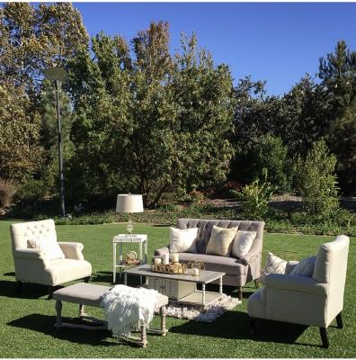 Pebble grey sofa / ivory tufted chairs lounge area